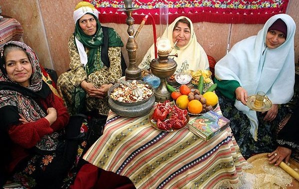 Iranian women in traditional dresses, celebrating Yalda Night